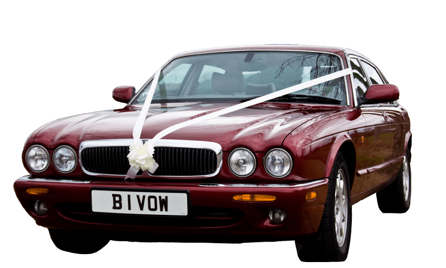 Ruby, our modern burgundy Jaguar XJ Executive