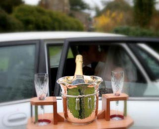 Enjoy a romantic glass of celebratory champagne in our Jaguar XJ.