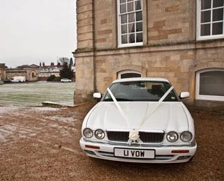 Our modern Jaguar XJ outside the wedding venue. Photo by Laura Rachel Photography - http://www.laurarachel.co.uk