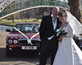 A couple pose for photographs with our burgundy Jaguar XJ and Harriet, our white Vintage Citroen. Photo by Just-Shoot-Me Photography - http://www.just-shoot-me.co.uk