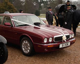 Our burgundy Jaguar XJ is well suited for any wedding transport role. Photo by Just-Shoot-Me Photography - http://www.just-shoot-me.co.uk