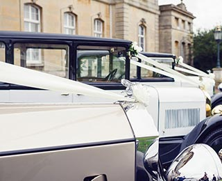 A collection of our stunning wedding cars, led by Grace, our newest wedding car to be restored.