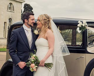 The wedding couple enjoying photos with Grace, our vintage Rolls Royce. Photo by Laura Rachel Photography - http://www.laurarachel.co.uk