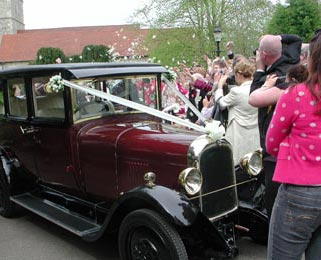 Action packed shot with confetti and Dorothy, our burgundy Vintage Citroen.