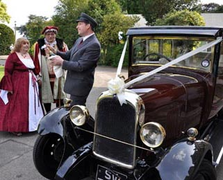 Dorothy, our burgundy Vintage Citroen, attends a wonderfully original Henry VIII themed wedding! Photo by Laura Rachel Photography - http://www.laurarachel.co.uk