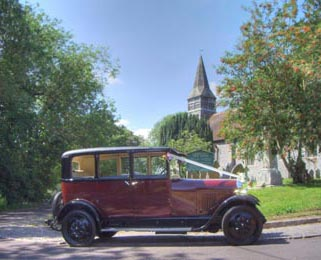 A scenic image of our Vintage Citroen outside a church whilst we were waiting during the ceremony.