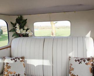 The interior has been reupholstered to the same high standard as our other vintage wedding cars. Photo by Laura Rachel Photography - http://www.laurarachel.co.uk