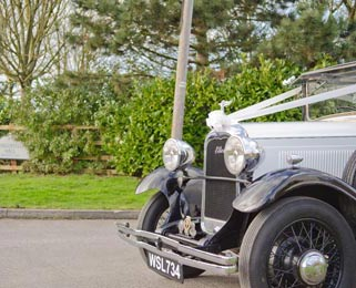 Arriving at Longueville Hall in Ellen, one of our most recently restored vintage cars. Photo by Laura Rachel Photography - http://www.laurarachel.co.uk