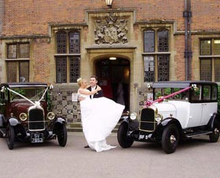 The happy couple celebrate after the ceremony with Harriet (white) and Dorothy (burgundy) 2 of our lovely vintage Citroens. Photo by Laura Rachel Photography - http://www.laurarachel.co.uk